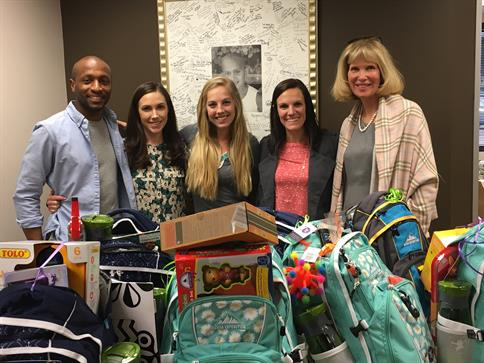 Heidi Culbertson (far right) stands with Northwestern Mutual Recruiters behind some of the Bags of Fun.